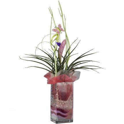 Jarron-de-cristal-con-arena-y-flor