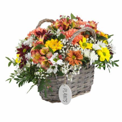 Cesta de flor en tonos cálidos - Flores Núñez